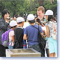 Students chat with American at Hiroshima Peace Park.